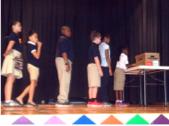 "Students demonstrating use of the, ""No Bullying,"" box."
